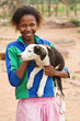 African girl with a puppy, rural area near Kalahari desert
