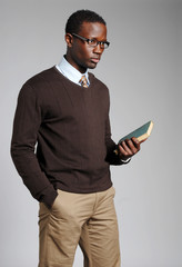 Young African American Male Reading Book