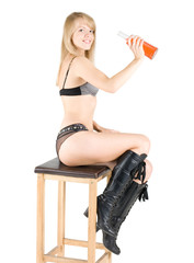 Beautiful barmaid girl sitting on high chair