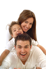 Excited, happy young family in a joyful huddle