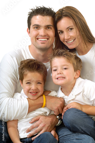 Modern, attractive young family hugging and laughing together