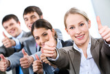 Fototapety Portrait of business people giving the thumbs-up sign