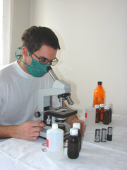 Doctor looking through the microsope ocular