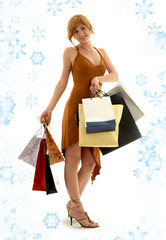 pretty redhead girl with shopping bags and snowflakes