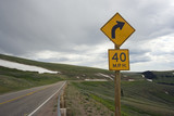 Curve Ahead - Slow Down!.Wyoming, USA. poster