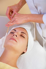Facial cryogenic massage in spa salon