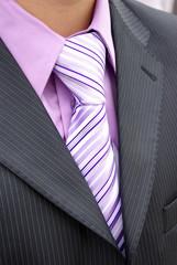 White carnation buttonhole on dark suit
