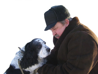 Elderly the man with spaniel