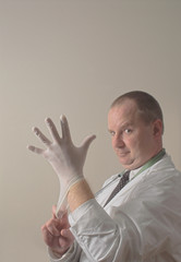 A proctologist preparing for a patient examination.