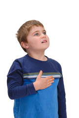 Child with hand on chest looking up
