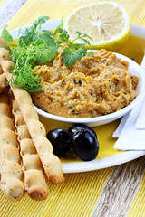 Hummus dip served with lemon, cilantro or coriander