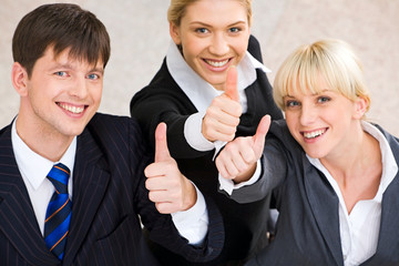 Portrait of three business people showing a sign of okay