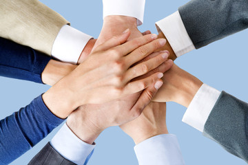 Photo of business people's hands on top of each other