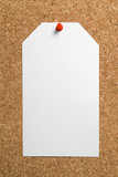 Blank paper tag on cork board background poster