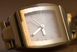 Old golden womans watch with the scratched slightly glass. poster