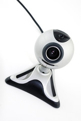 Silver webcam isolated against a white background