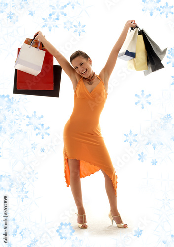 happy girl with shopping bags and snowflakes