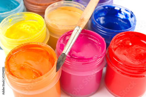 Multicolored gouache paints and paintbrush
