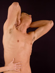 Naked torso of man with female's hand