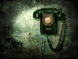 Old phone on the destroyed wall - 5596240
