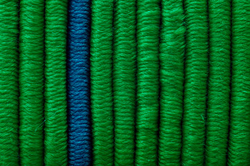 One blue and many green vertical straight elastics