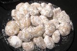 Delicious homemade butter cookie balls with powdered sugar. poster
