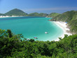 Boats over a crystalline turquoise sea in Arraial do Cabo