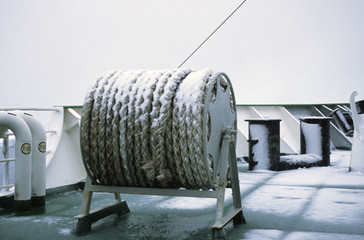 A snow-covered winch