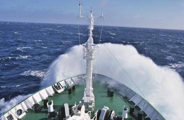 Boat in crashing waves
