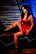 woman in the red dress provocative pose at night graffiti