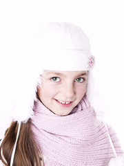 Closeup of girl, wearing wool winter hat and scarf