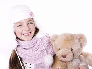 Closeup of girl with teddy bear