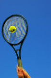 Tennis player swinging and hitting the ball poster