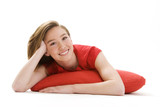 pretty Young girl fair with the elbows on a red cushion poster