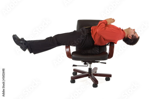 Unusual businessman relaxing on the office chair - isolated