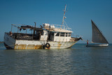 rusted fishing boat and a dhow on the islands