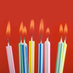 studio shot close up of lite birthday candles