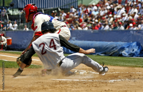 baseball player sliding into home plate