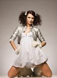 beautiful brunette winter girl wearing furry gloves  poster