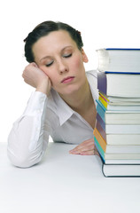 Young woman with piled up books on the desk