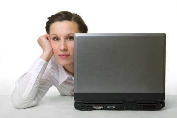portrait of caucasian woman hiding behind her laptop
