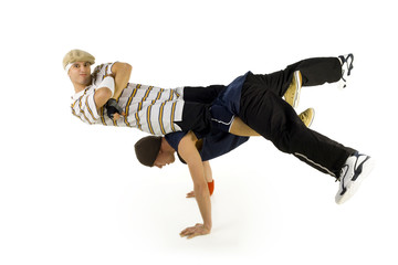 Two bboys doing some kind of exercise.