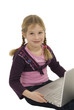 a little cute girl with a laptop against white background