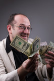 middle-aged successful businessman with money - greed concept poster
