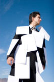 Businessman covered with white papers poster