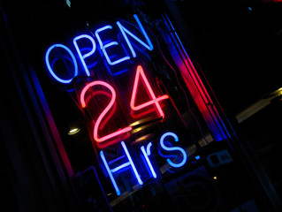 pink & blue neon Open 24 hours sign at night