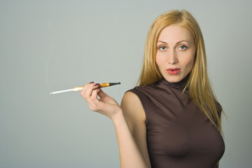 blond woman hold cigarette in hand