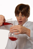 worried lady scientist pouring liquid poster