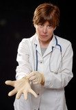 doctor putting on latex gloves poster