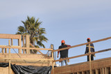 hispanic carpenters working on an apartment building